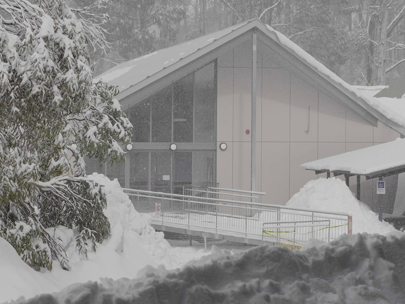 An exterior image of the All Access Abilities Building at Howmans Gap Alpine Centre during winter.
